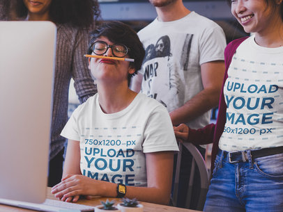 Girl Laughing at a Coworker Playing with a Pen Wearing T-Shirts Mockup a20396