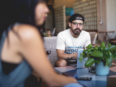 Mockup of a Man with a Beard Wearing a T-Shirt while Looking at a Girl a20410