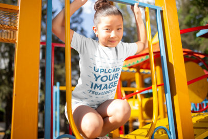 Mockup of a Girl Wearing a T-Shirt at a Playground a20957
