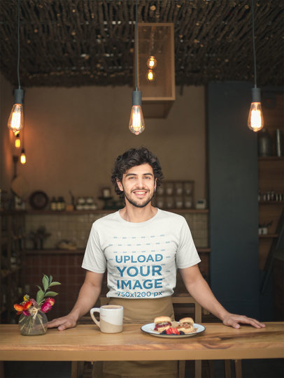 T-Shirt Mockup of a Smiling Waiter Wearing a Brown Waist Apron a20472