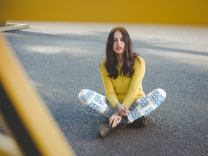 Leggings Mockup of a Girl Wearing a Yellow Sweater while Sitting on the Street a19061