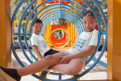 T-Shirt Mockup of Two Asian Children at a Playground a20960