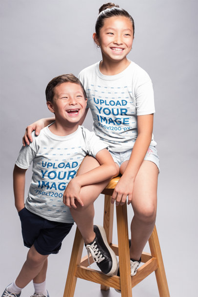 Mockup of Smiling Kids Wearing T-Shirts in a Photo Studio a20950