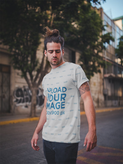 T-Shirt Mockup of Man with Manbun Walking Down the Street 19936a