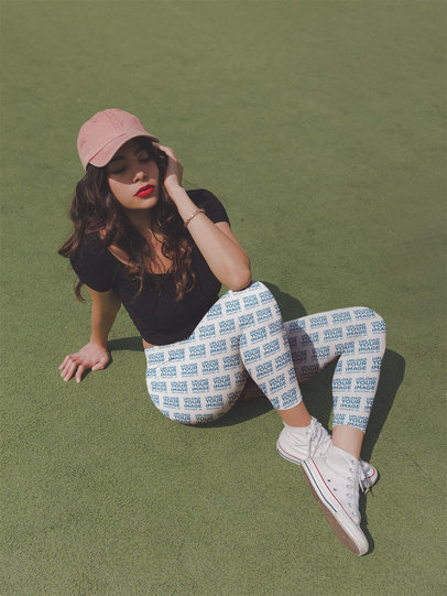 Leggings Mockup Featuring a Girl with Red Lips Posing on a Green Carpet a19045