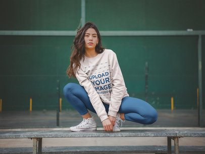 Crewneck Sweatshirt Mockup of a Woman Crouching on a Steel Beam a19049
