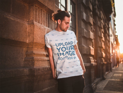 Mockup of a Man Wearing a Sublimated T-Shirt while Leaning Against a Historical Building a19938