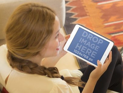 Woman On a Couch Holding Her iPad
