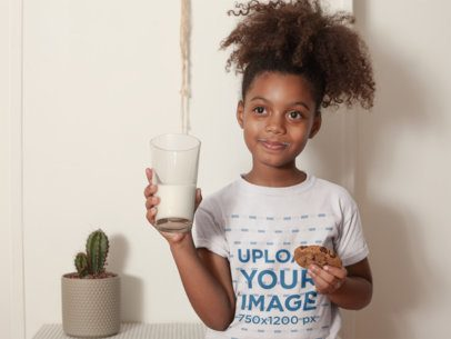 T-Shirt Mockup of a Black Child Having a Glass of Milk and a Cookie a21327