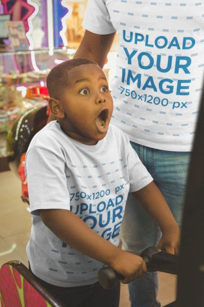 T-Shirt Mockup of an Excited Black Kid Playing at the Arcade with his Dad a20544