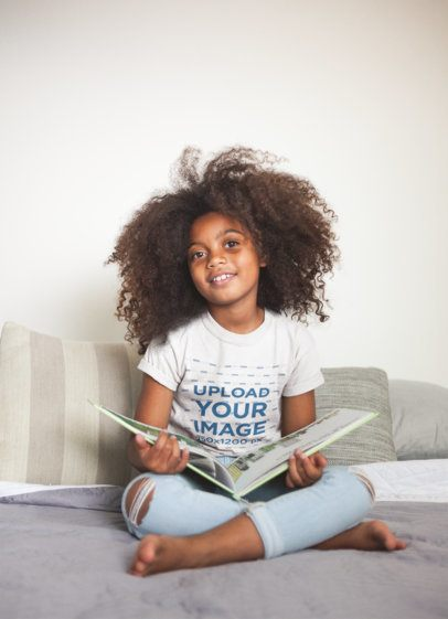 Mockup of a Little Black Girl Wearing a T-Shirt while Reading a21320