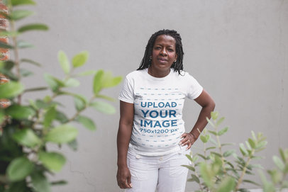 Mockup of a Senior Woman with Braids Wearing a T-Shirt Against a Concrete Wall a21408