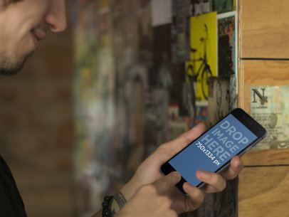 Hip Young Man Using Black iPhone 6 Mockup Template