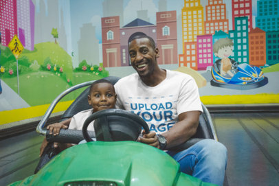 Mockup of a Black Man Wearing a T-Shirt with his Son on a Bumper Car a20542