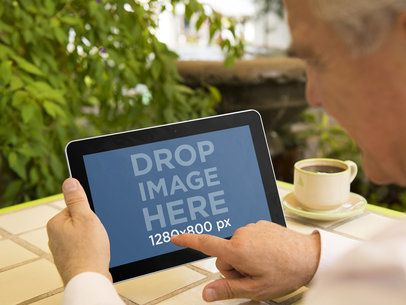 Elderly Man With Android Tablet at Terrace Mockup Template