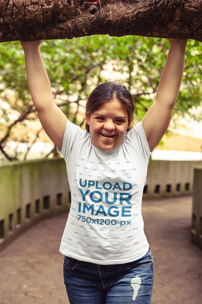 Mockup of a Happy Girl with Down syndrome Wearing a Tshirt a21381