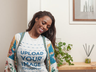 Mockup of a Happy Black Woman Wearing a T-Shirt at Home a21328