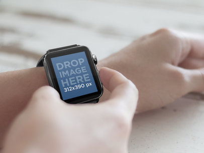 Young Man Using Black Apple Watch Over Wooden Table Mockup