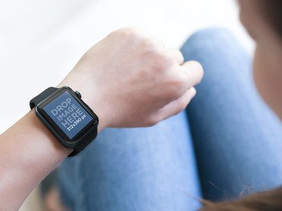 Mockup of Young Woman Wearing a Black Apple Watch and Sitting on the Stairs