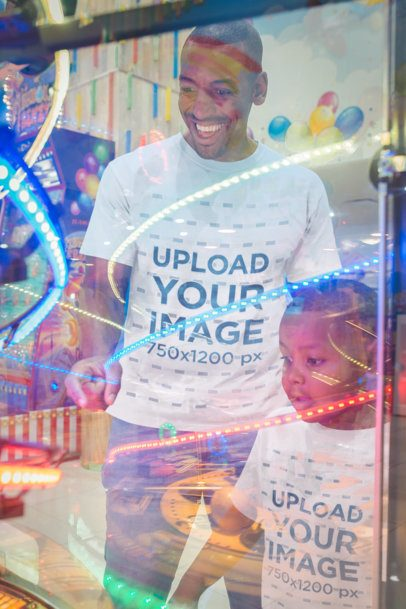 Mockup of a Man Wearing T-Shirts with his Son at the Video Arcade a20549