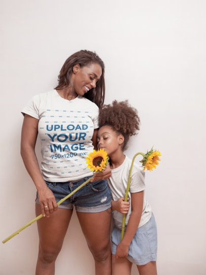 T-Shirt Mockup of a Happy Woman Holding Sunflowers with her Daughter a21331