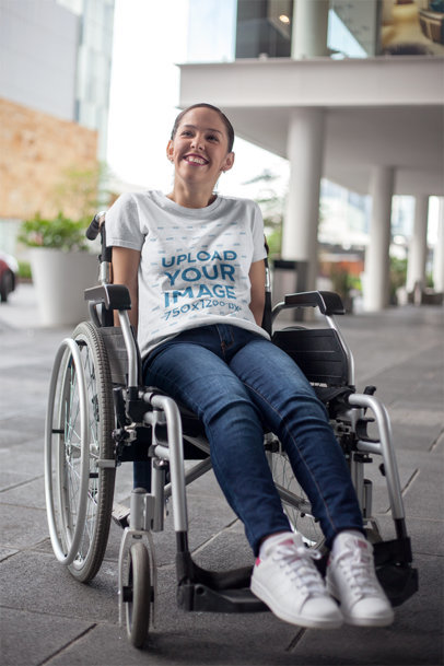 Mockup of a Happy Girl Wearing a T-Shirt Sitting on a Wheelchair a21361
