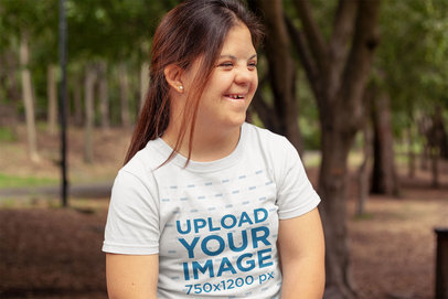 T-Shirt Mockup of a Smiling Woman at a Park a21388