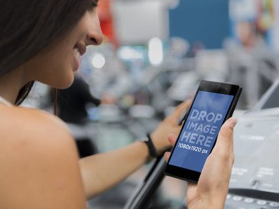 Mockup of a Beautiful Woman on Treadmill Using an Android Smartphone
