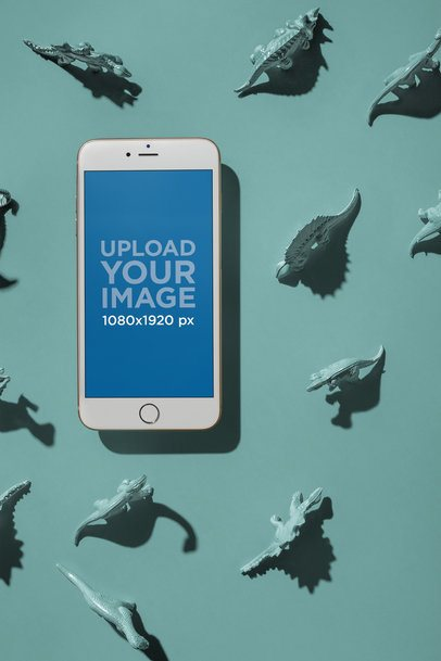 Gold iPhone 8 Plus Mockup Floating Surrounded by Dinosaur Toys a21490