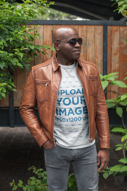 Mockup of a Black Man Wearing a Tshirt and a Brown Leather Jacket a21425