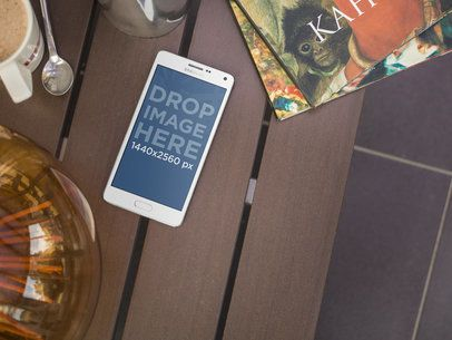 Android Mockup Template on Table Featuring Art Books