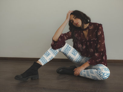 Mockup of a Girl Wearing Leggings Sitting on a Wooden Floor a19147