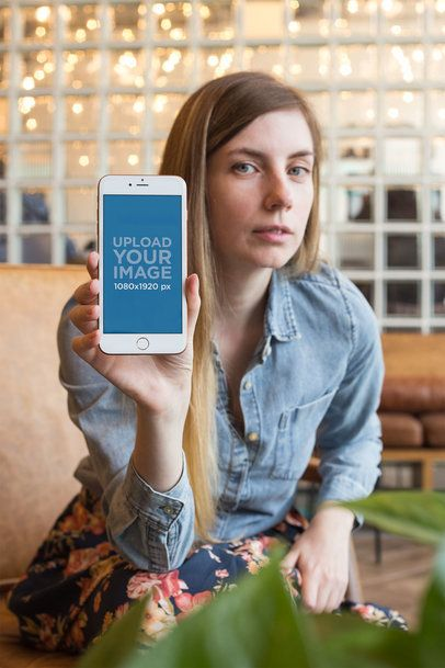 Mockup of a Woman with a Denim Jacket Showing her Rose Gold iPhone a21504