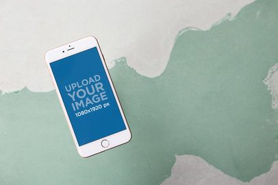 Mockup of an iPhone Floating Over a White and Green Surface a21611