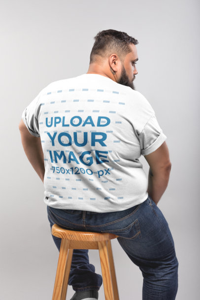 Back Shot of a Plus Size T-Shirt Mockup Featuring a Man Sitting on a Stool 20798