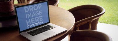 Laptop Mockup of a MacBook on Outdoor Patio Dining Table