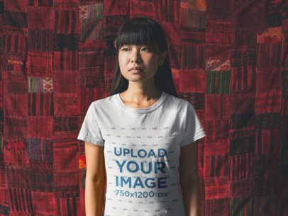 T-Shirt Mockup Featuring an Asian Girl Standing Against a Big Red Cloth 20566
