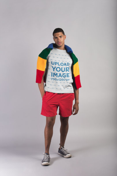T-Shirt Mockup of a Man with Beach Clothing in a White Room 21078