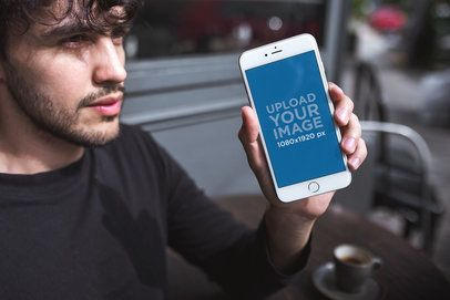 Mockup of a Man with a Beard Showing his Silver iPhone 8 Plus a21608
