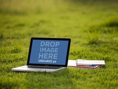 Mockup of a Macbook Pro Lying on the Grass