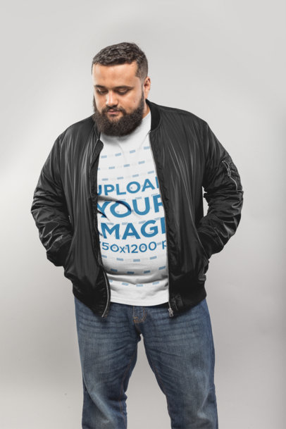 Plus Size T-Shirt Mockup Featuring a Man Wearing a Black Bomber Jacket 20806