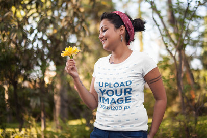 Tshirt Mockup of a Smiling Girl Holding a Flower 20577