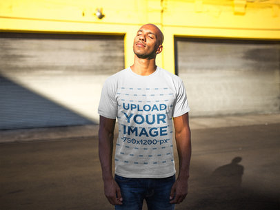 T-Shirt Mockup Featuring a Man on the Street Facing the Sun 18315