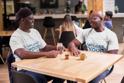T-Shirt Mockup of Two Brothers Sitting at a Cafe 21473