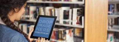 Black iPad Mockup Featuring a Girl at the Library