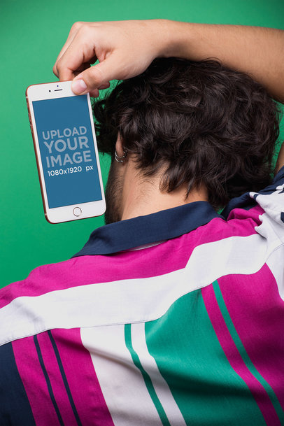 Mockup of a Man Holding an iPhone Over his Head 21739