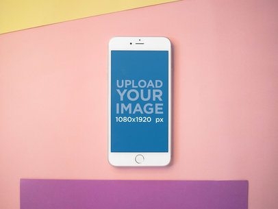 Mockup of an iPhone Lying on a Pink Surface with Purple and Yellow 21639