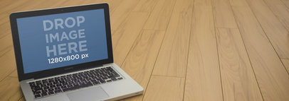 Mockup Template of a Macbook Pro Over Wooden Deck Floor