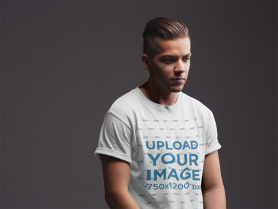 Mockup Featuring a Stylish Young Man Wearing a  T Shirt Against a Dark Gray Background 21015