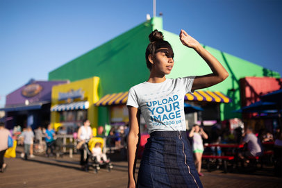 Mockup of a Girl Wearing a T-Shirt by an Amusement Park's Stores 18320
